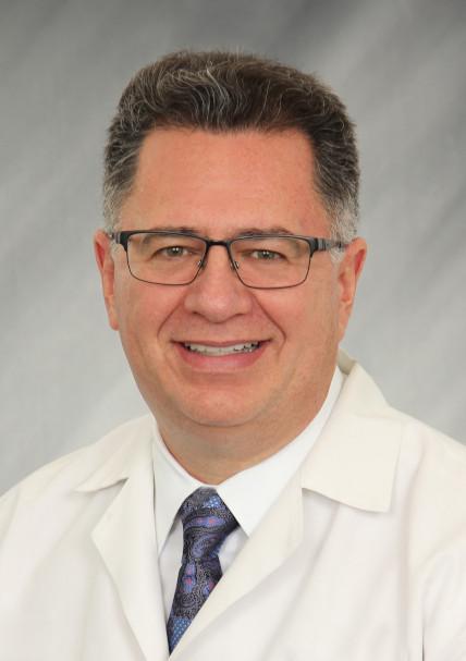 Daniel E. McGuire, MD, FACP, FACG